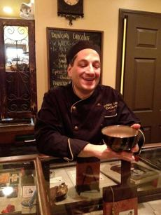 for Food - 08travfood - Dancing Lion Chocolate owner Richard Tango-Lowy serves a bowl of drinking chocolate in his Elm Street shop in Manchester, N.H. Dancing Lion Chocolate and Manchester NH. (Kathleen Pierce for the Boston Globe)